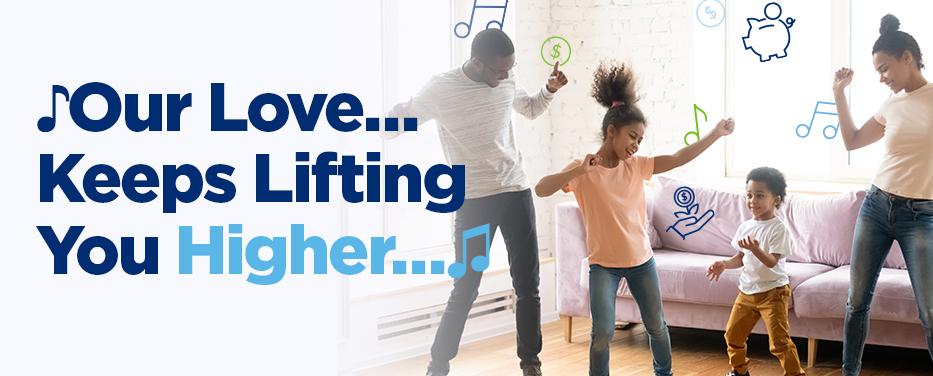 Happy family dancing in living room.