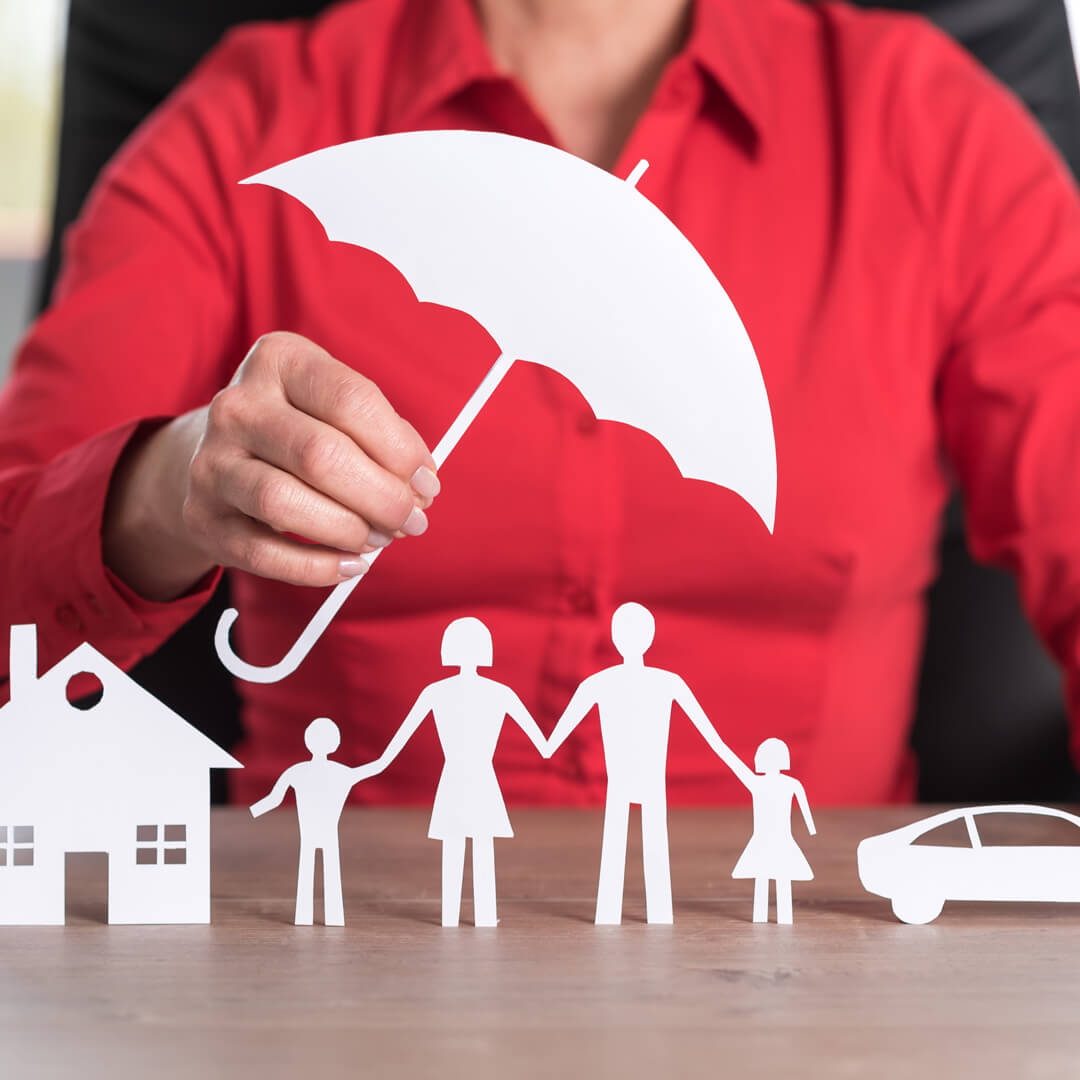 Cut out of home, family, and automobile with an umbrella over, representing umbrella insurance